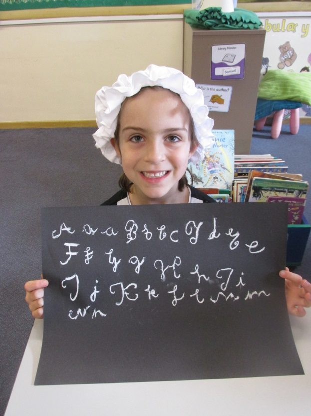 Downsend pupil writes calligraphy with chalk