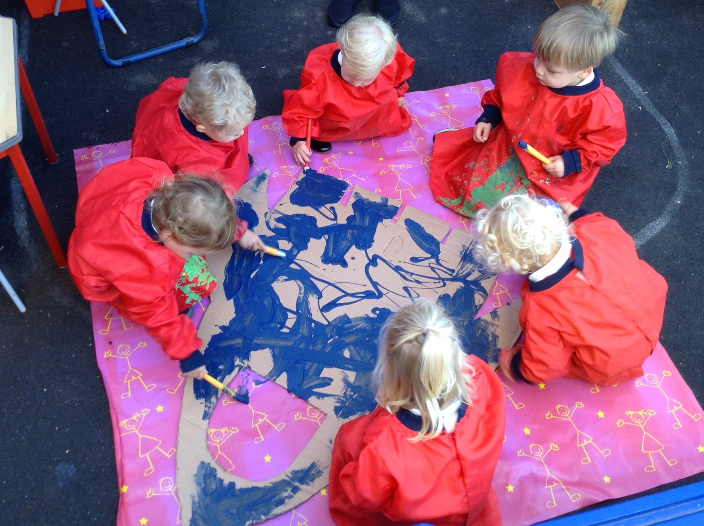Ashtead pupils enjoy painting on the ground